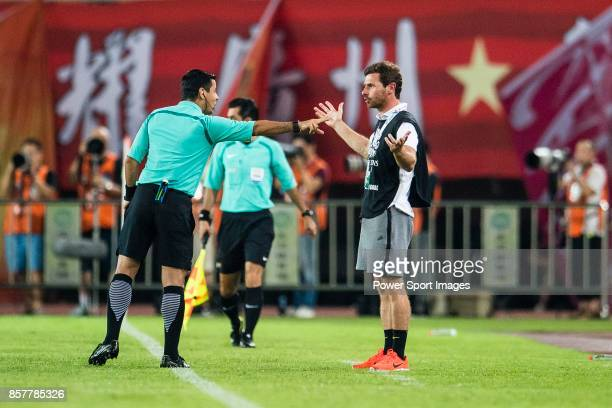 Fifa Referee Alireza Faghani of Iran gestures for Shanghai FC Head Coach Andre VillasBoas during the AFC Champions League 2017 QuarterFinals match...
