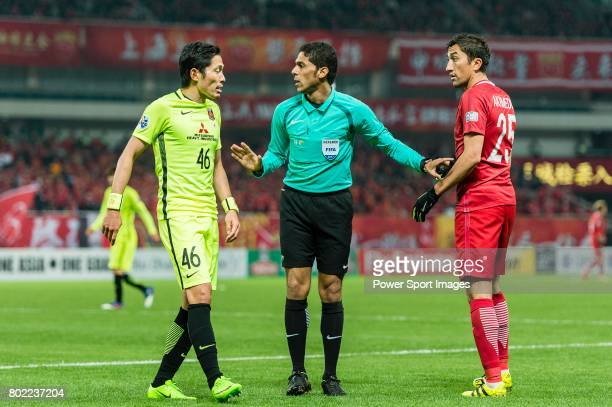 Fifa Referee Fahad Almirdasi of Saudi Arabia talks with Urawa Reds Defender Moriwaki Ryota and Shanghai FC Midfielder Akhmedov Odil during the AFC...