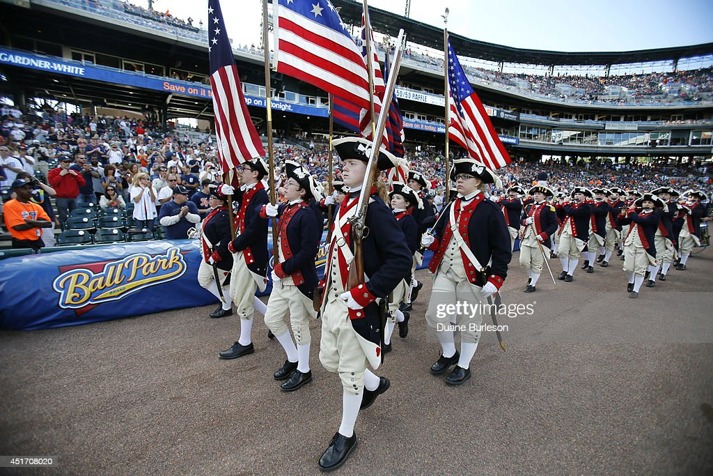 A fife and drum corp entertain the fans before the Detroit Tigers game against the Tampa Bay Rays at Comerica Park on July 4, 2014 in Detroit, Michigan.