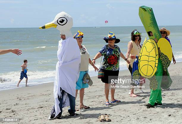Fifteen people joined hands on the beach in front of Plyler Park in Myrtle Beach South Carolina joining people around the world on beaches and in...