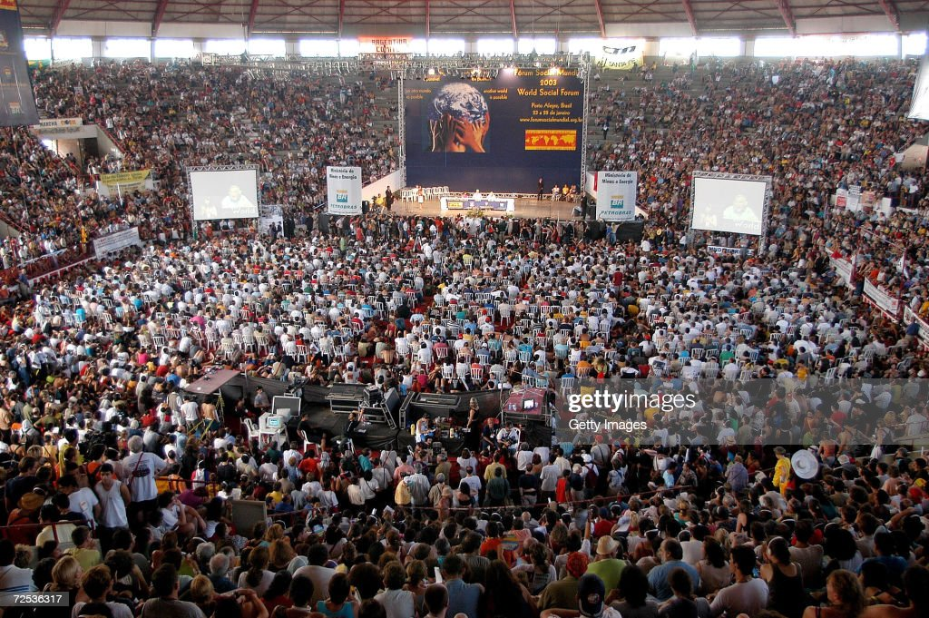Fifteen thousand people pack a stadium to hear American linguist and social activist Noam Chomsky and Indian activist Arundhati Roy speak at the...