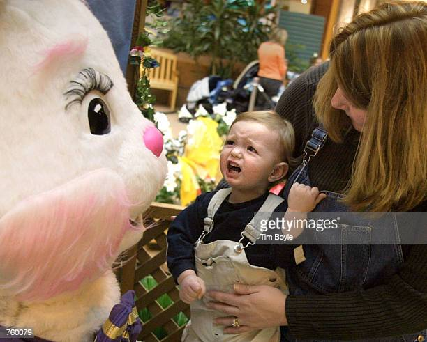 Fifteenmonthold Jack Dullum in the arms of his mother Chris Dullum from Niles IL reacts as he meets the Easter Bunny March 28 2002 at Golf Mill...