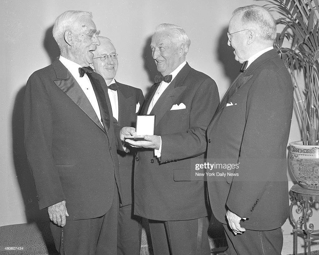 Fifth Annual Banquet of The American Historical Society at Hotel Biltmore. Joseph Scott, lawyer, Los Angeles; Garth Healy, Consul General Ireland; Senator Patrick A. McCarran Nevada and James McGurrin, President General of above Society. Joseph Scott made the presentation of the Society's medal to Senator McCarran in admiration of his service to the Republic Mathewson, Hal/NY Daily News via Getty Images)