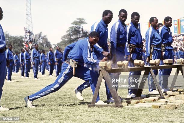 Fifth brigade of Zimbabwean army trained by North Koreans pratices karate in May 1984 at the Rufaro stadium in Harare / AFP PHOTO / ALEXANDER JOE