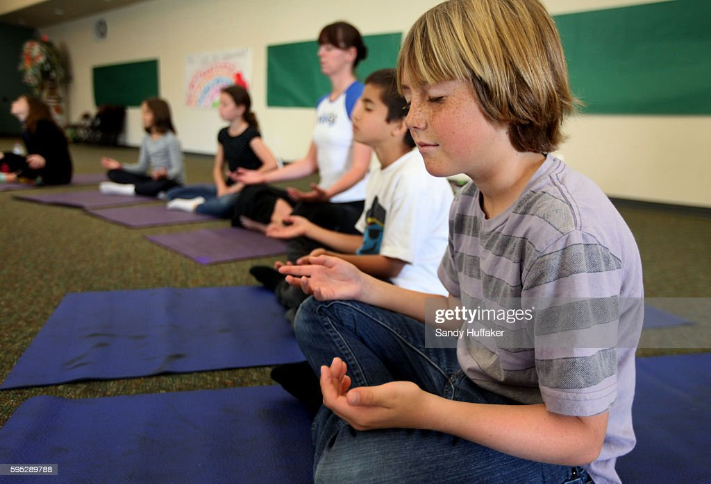 Fifth grade students including Noah SlawsonR engage in Yoga during a class at Paul Ecke Central Elementary School in Encinitas CA on Monday March 14...