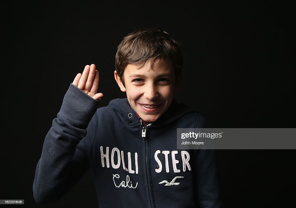 Fifth grader Theodore Poncet , 10, born in France, holds his hand as for the oath of allegiance while awaiting his American citizenship certificate at the U.S. Citizenship and Immigration Services (USCIS), office on February 19, 2013 in New York City. His mother is a marketing consultant, and the family lives in New York City. Almost 300 foreign-born children of naturalized immigrants received citizenship certificates Tuesday at the USCIS center during the special event. Children of naturalized immigrants receive U.S. citizenship if they arrive to the United States as minors, but they must go through a process at USCIS to receive official citizenship documents proving they have become Americans.