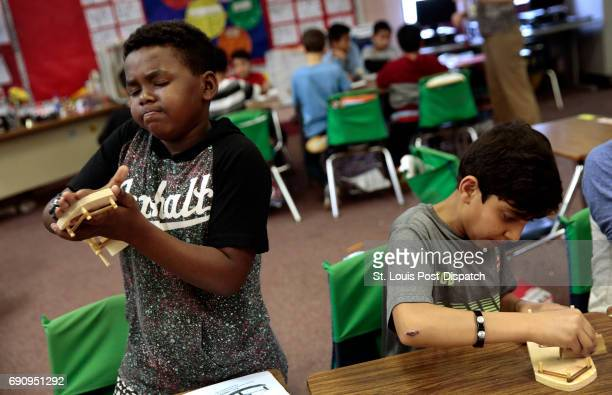 Fifth graders Sem Birke left of Ethiopia and Hilal Safi of Afghanistan sand their paddle wheelers as they make crafts on Thursday April 20 2017 at...