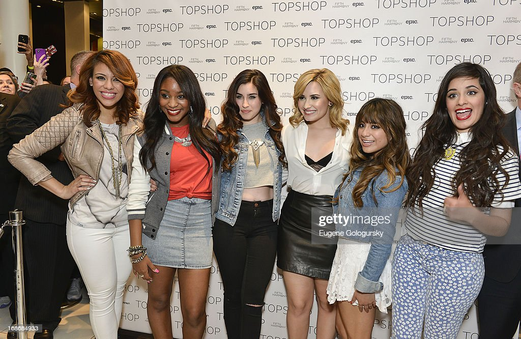 <a gi-track='captionPersonalityLinkClicked' href=/galleries/search?phrase=Fifth+Harmony&family=editorial&specificpeople=9960104 ng-click='$event.stopPropagation()'>Fifth Harmony</a> and <a gi-track='captionPersonalityLinkClicked' href=/galleries/search?phrase=Demi+Lovato&family=editorial&specificpeople=4897002 ng-click='$event.stopPropagation()'>Demi Lovato</a> (C) attend at TopShop on May 13, 2013 in New York City.