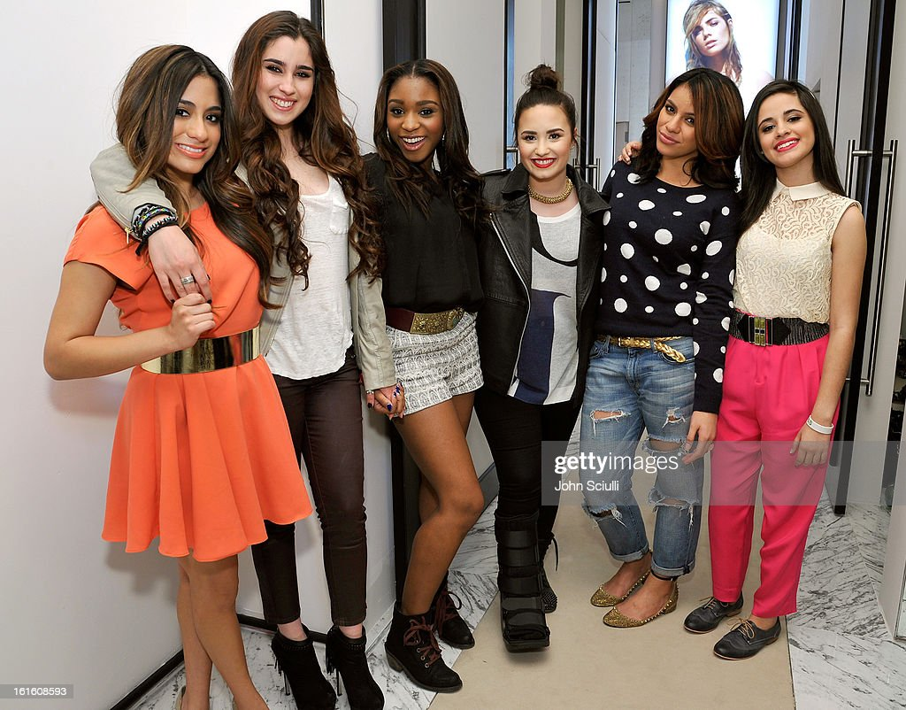 Fifth Harmony and <a gi-track='captionPersonalityLinkClicked' href=/galleries/search?phrase=Demi+Lovato&family=editorial&specificpeople=4897002 ng-click='$event.stopPropagation()'>Demi Lovato</a> (C) attend the press day at Topshop Topman at the Grove on February 12, 2013 in Los Angeles, California.