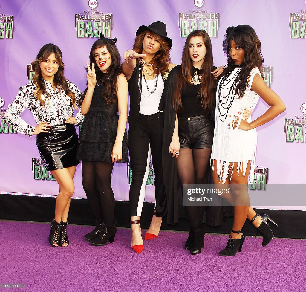 <a gi-track='captionPersonalityLinkClicked' href=/galleries/search?phrase=Fifth+Harmony&family=editorial&specificpeople=9960104 ng-click='$event.stopPropagation()'>Fifth Harmony</a> arrive at Hub Network's 1st Annual Halloween Bash held at Barker Hangar on October 20, 2013 in Santa Monica, California.
