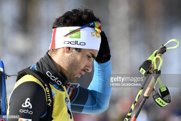 Fifth placed Martin Fourcade of France gestures after the men's 125 km pursuit at the IBU Biathlon World Cup in Kontiolahti Finland on March 11 2017...