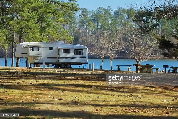 Fifth wheel camper on lake