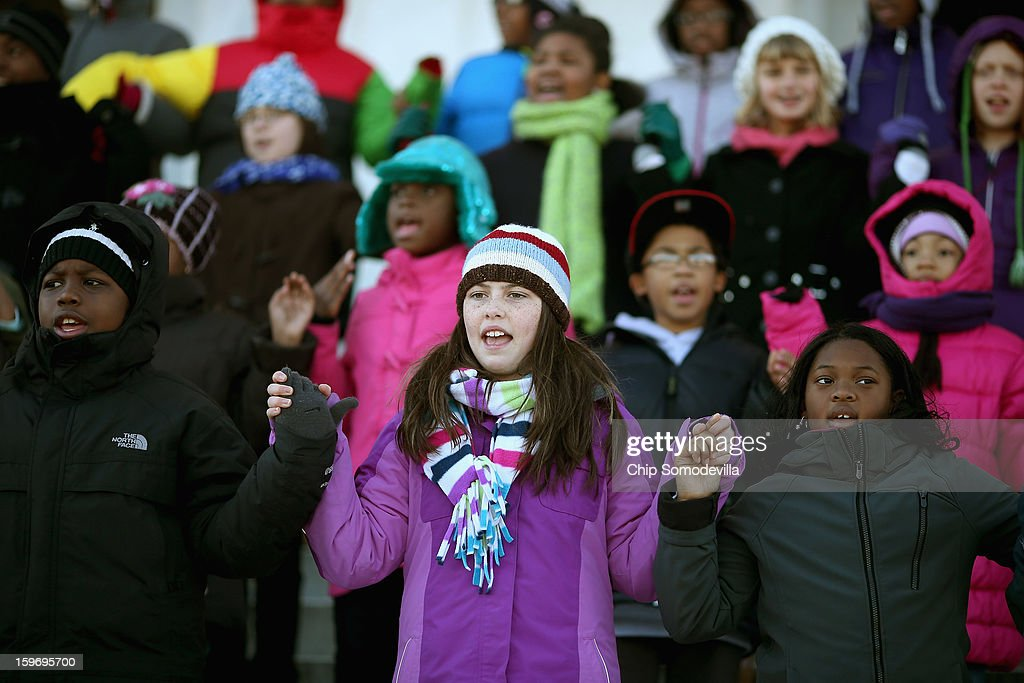 Fifth-graders from Watkins Elementary School in the District of Columbia sing 'We Shall Overcome' during a celebration of Martin Luther King Jr.'s birthday on the steps of the Lincoln Memorial on the National Mall January 18, 2013 in Washington, DC. The students each took turn reciting from memory parts of the 'I Have a Dream' speech from the very spot where King originally delivered the oration in August of 1963.