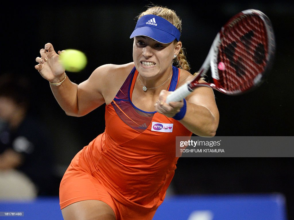 Fifthseeded Angelique Kerber of Germany hits a return during her women's singles third round match against 11thseeded Ana Ivanovic of Serbia at the...