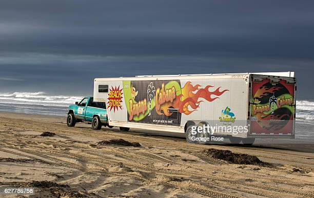A fifthwheel truck pulls a travel trailer along the sand at Oceano Dunes/Pismo Beach State Park on November 27 near Pismo Beach California Because of...