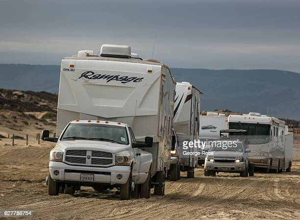 Fifthwheel trucks pull travel trailers along the sand at Oceano Dunes/Pismo Beach State Park on November 27 near Pismo Beach California Because of...