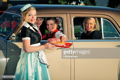 Fifties Drive In With Car Hop and Customers