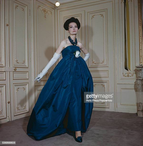Fifties Fashion A female model wears an evening gown in tealblue faille by Pierre Cardin from the 1958 AutumnWinter season consisting of an ultrafull...