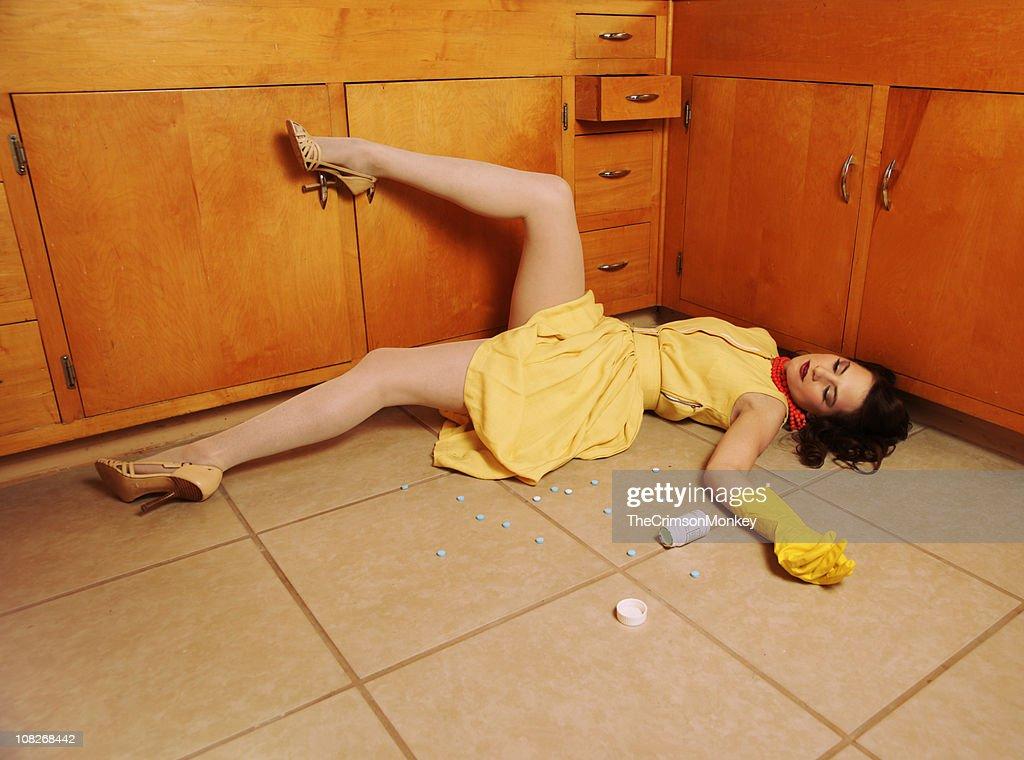 Fifties Housewife Sprawled on Floor : Stock Photo