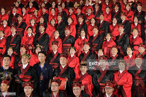 Fifty married couples wearing Han Chinese clothes attend a group wedding ceremony at the foot of Mount Tai on May 19 2015 in Tai an China