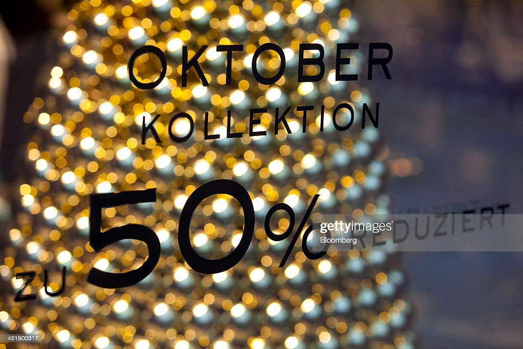 A fifty percent sale reduction sign sits in a Christmas window display at the Mango fashion clothing store in Munich, Germany, on Sunday, Nov. 24, 2013. In Germany, Europe's biggest economy, annual consumer prices increased 1.2 percent in October. Photographer: Krisztian Bocsi/Bloomberg via Getty Images