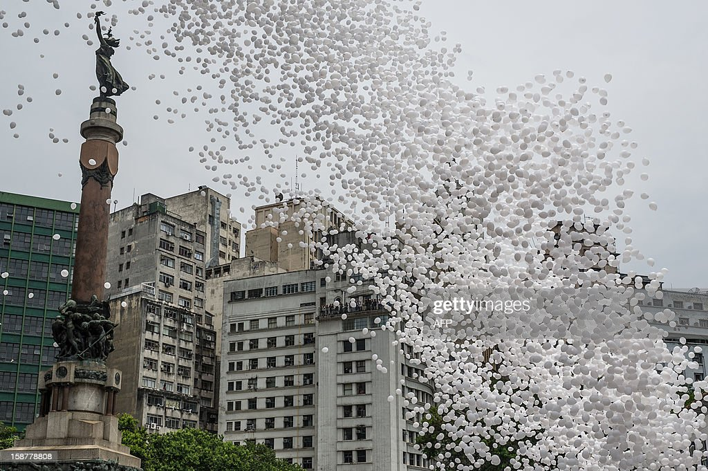 Fifty thousand biodegradable balloons are released by Sao Paulo's Commercial Association (ACSP) at Patio do Collegio, the historical Jesuit church and school founded in 1554 as the foundation of the city, Sao Paulo, Brazil, on December 28, 2012. An office boy first released 100 balloons in 1992 and the event then turned into tradition for celebrating New Year when ACSP took over. AFP PHOTO/YASUYOSHI CHIBA