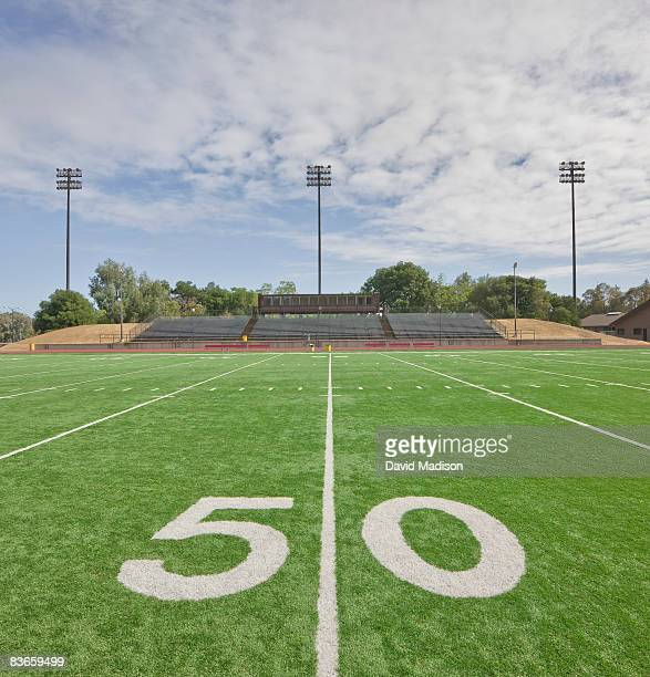 Fifty yard line and empty stands on football field
