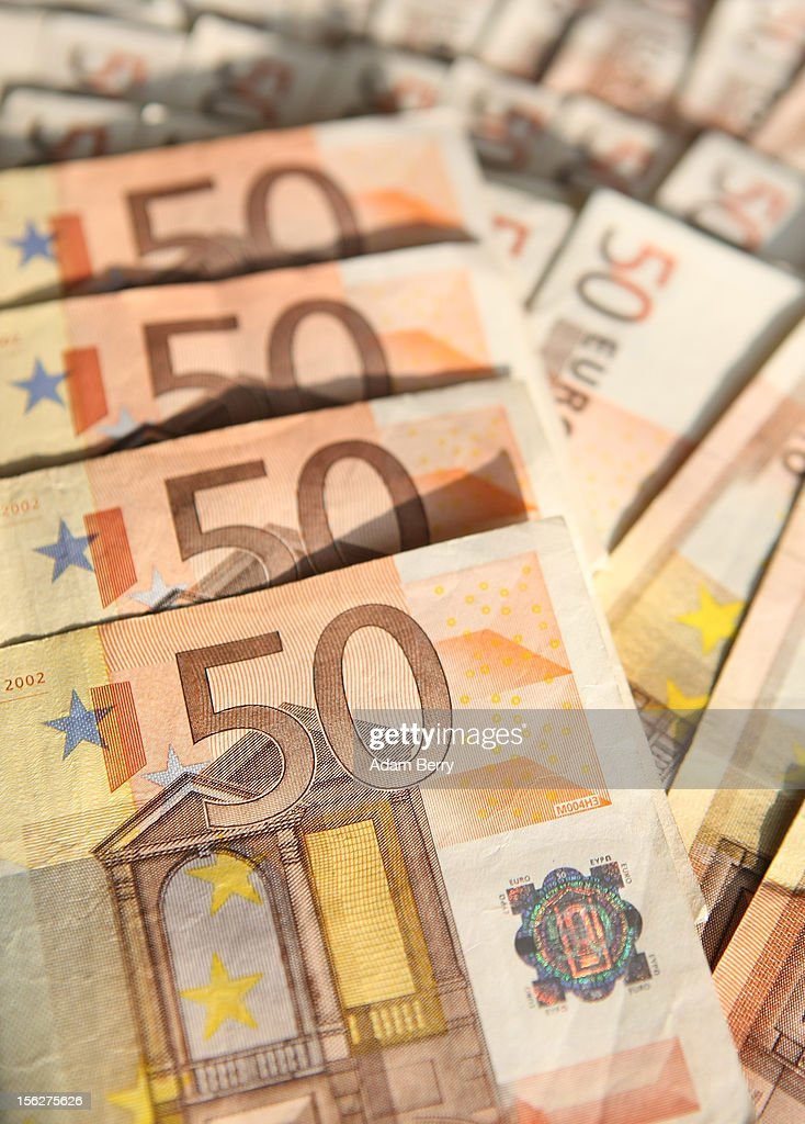 Fifty-euro notes lie on a table for a photo illustration on November 12, 2012 in Berlin, Germany. The euro fell against the dollar on Friday to its lowest level in two months, bringing concerns that the region's debt crisis and worsening economic situation could hinder global economic growth.