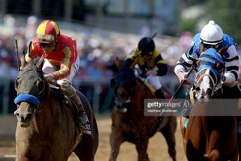 Fiftyshadesofhay (L), ridden by <a gi-track='captionPersonalityLinkClicked' href=/galleries/search?phrase=Joel+Rosario&family=editorial&specificpeople=6495860 ng-click='$event.stopPropagation()'>Joel Rosario</a>, crosses the finish line ahead of Marathon Lady, ridden by Robby Albarado, to win the 89th Black-Eyed Susan Stakes at Pimlico Race Course on May 17, 2013 in Baltimore, Maryland.