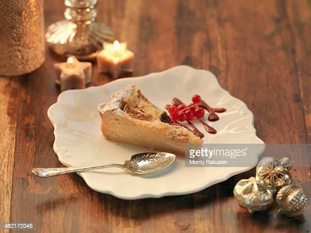 Fig and amaretto frangipane tart amid festive decorations