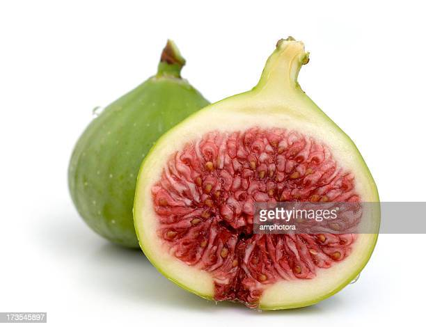 A fig cut in half on a white background