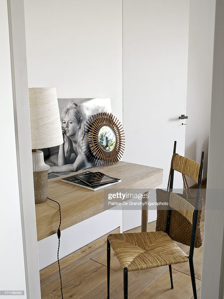 104642-007. A holiday home designed by architect Pierre Yovanovitch is photographed for Madame Figaro on May 1, 2013 in St Tropez, France. A photo of Brigitte Bardot against a background of natural materials inspired by the beaches of Pampelona. PUBLISHED IMAGE.