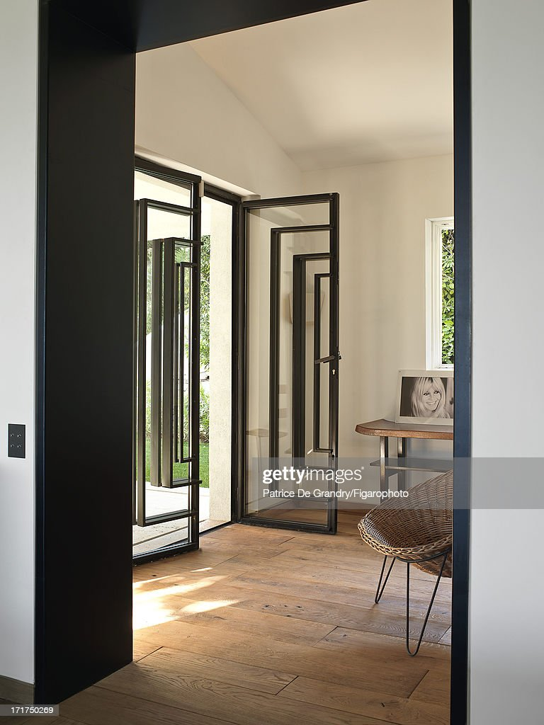 104642-008. A holiday home designed by architect Pierre Yovanovitch is photographed for Madame Figaro on May 1, 2013 in St Tropez, France. Metal doorway. PUBLISHED IMAGE.