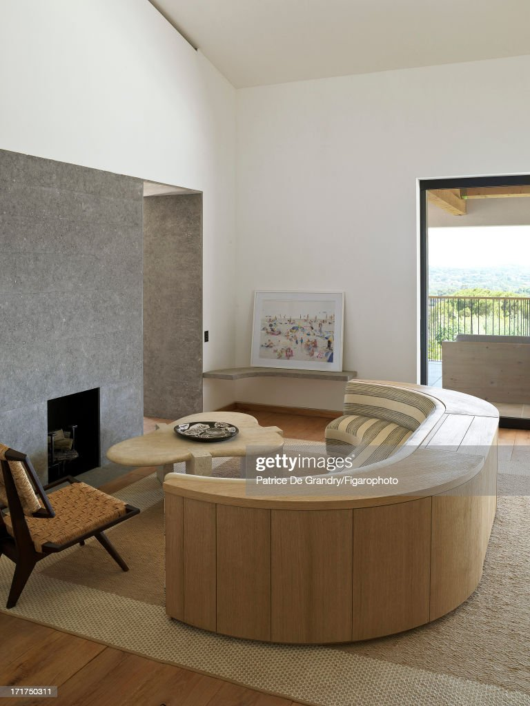 104642-014. A holiday home designed by architect Pierre Yovanovitch is photographed for Madame Figaro on May 1, 2013 in St Tropez, France. The living room.