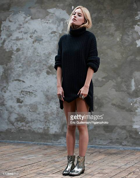 Figaro ID 105033004 Model Camille Rowe is photographed for Madame Figaro on September 27 2012 in Paris France Sweater and boots rings Low Luv ring...