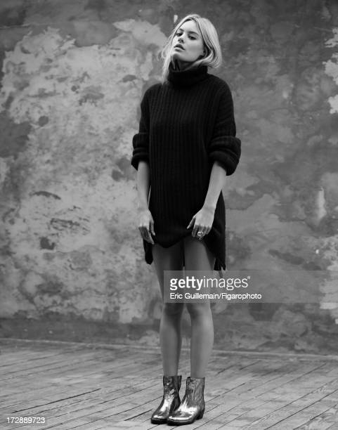 Figaro ID 105033008 Model Camille Rowe is photographed for Madame Figaro on September 27 2012 in Paris France Sweater and boots rings Low Luv ring...
