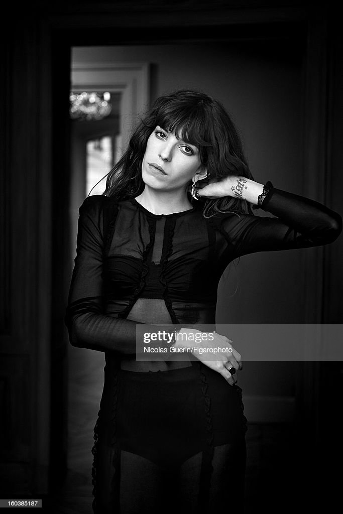 105335-006. Model <a gi-track='captionPersonalityLinkClicked' href=/galleries/search?phrase=Lou+Doillon&family=editorial&specificpeople=208822 ng-click='$event.stopPropagation()'>Lou Doillon</a> is photographed for Madame Figaro on November 13, 2012 in Paris, France. PUBLISHED IMAGE. Dress and lingerie by Dolce & Gabbana, earrings by Pomellato, personal ring. Make-up by La Roche-Posay.