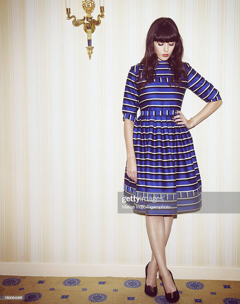 105403-005. Singer Nolwenn Leroy is photographed for Madame Figaro on December 7, 2012 in Paris, France. PUBLISHED IMAGE. Dress by Olympia Le-Tan, bracelets by Stone, ring by Ahkah, shoes by Roger Vivier.