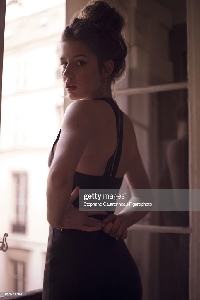 105833-007. Actress Adele Exarchopoulos is photographed for Madame Figaro on January 15, 2013 in Paris, France. Dress (DROMe), earrings (Corpus Christi). PUBLISHED IMAGE.