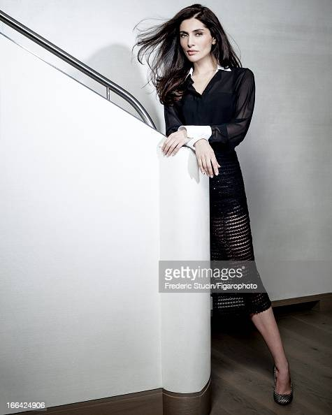 Figaro ID# 105949002 Actress Caterina Murino is photographed for Madame Figaro on January 23 2013 in Paris France Shirt and skirt camisole shoes...