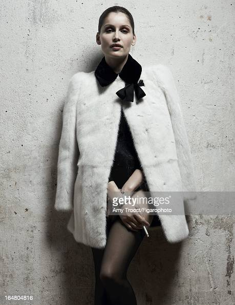 Figaro ID 106050005 Model Laetitia Casta poses for Madame Figaro on February 13 2013 in Paris France PUBLISHED IMAGE Coat body and stockings cuffs...