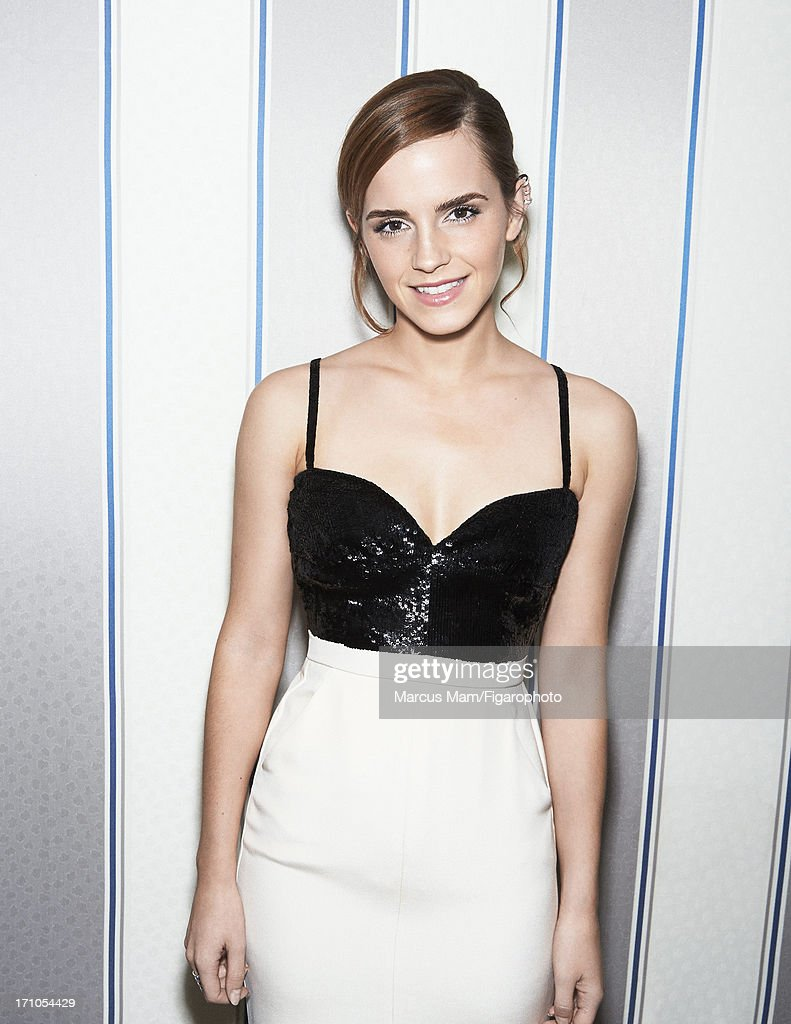 106430-019. Actress Emma Watson is photographed for Madame Figaro on May 18, 2013 at the Cannes Film Festival in Cannes, France. Dress (Chanel Haute Couture), earrings and ring (Repossi). PUBLISHED IMAGE.