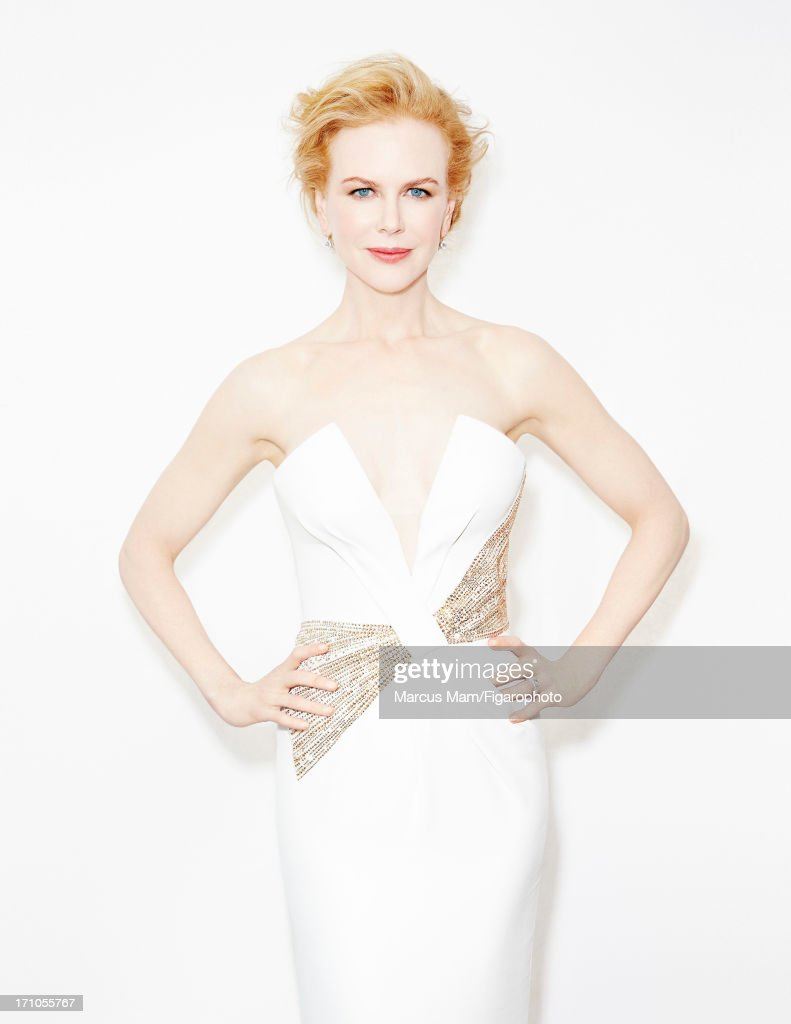 106430-025. Actress <a gi-track='captionPersonalityLinkClicked' href=/galleries/search?phrase=Nicole+Kidman&family=editorial&specificpeople=156404 ng-click='$event.stopPropagation()'>Nicole Kidman</a> is photographed for Madame Figaro on May 25, 2013 at the Cannes Film Festival in Cannes, France. Dress (Giorgio Armani), earrings and ring (Harry Winston). COVER IMAGE.