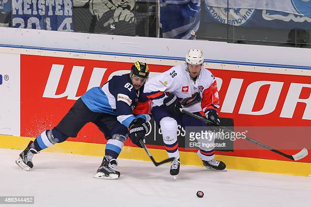 Fight between David Elsner and Calle Rosen during the Champions Hockey League group stage game between ERC Ingolstadt and Vaxjo Lakers on September 3...