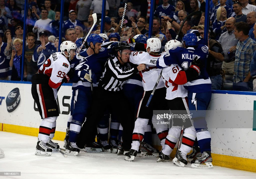 A fight between the Tampa Bay Lightning and the Ottawa Senators breaks out as time expires at the Tampa Bay Times Forum on April 9, 2013 in Tampa, Florida.