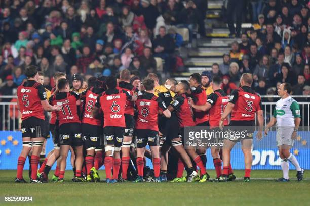 A fight breaks out between both teams during the round 12 Super Rugby match between the Crusaders and the Hurricanes at AMI Stadium on May 13 2017 in...
