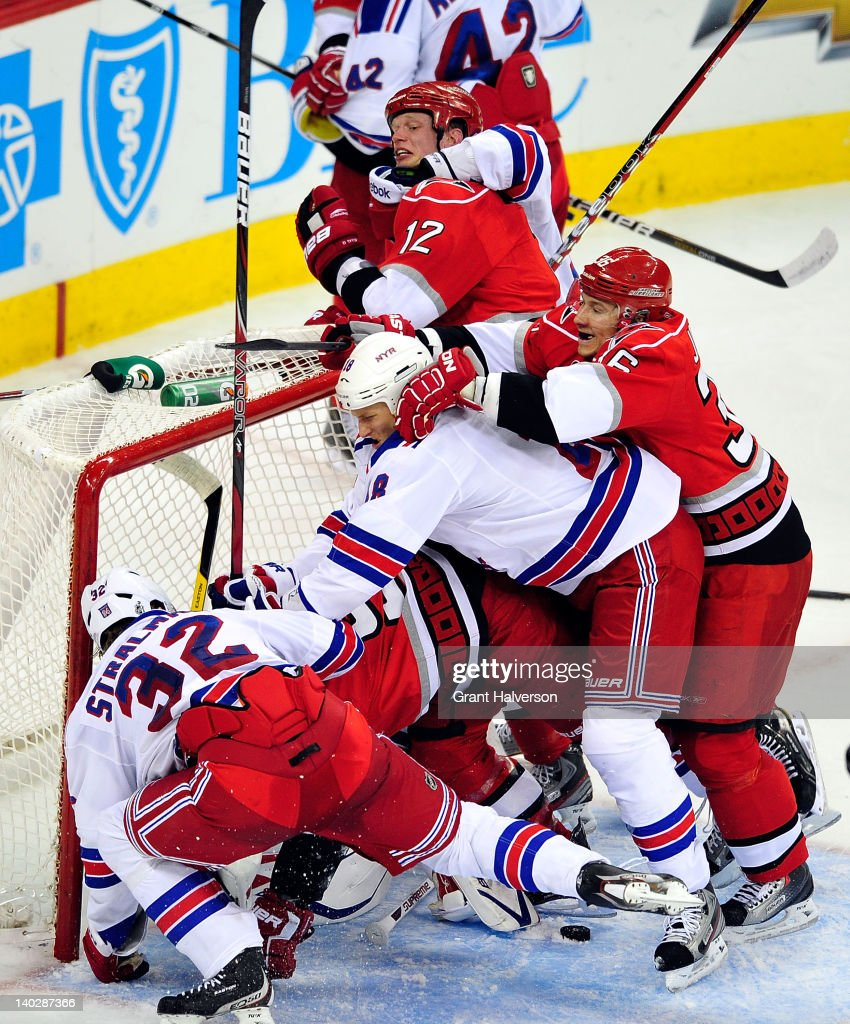 A fight breaks out between the New York Rangers and the Carolina Hurricanes in front of the New York net during play at the RBC Center on March 1, 2012 in Raleigh, North Carolina. The Rangers won 3-2.