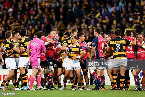 A fight breaks out during the ITM Cup Premiership Final match between Taranaki and Tasman at Yarrow Stadium on October 25 2014 in New Plymouth New...