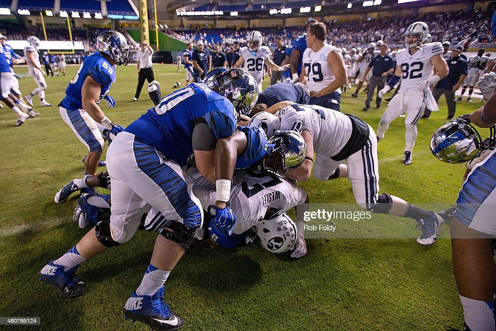 A fight breaks out on the field after the game between the Brigham Young Cougars and the Memphis Tigers at Marlins Park on December 22 2014 in Miami...