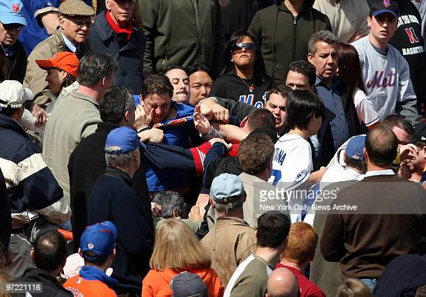 A fight in the crowd in the 5th inning of the Mets 52 loss to the Phillies New York Mets home opener against the Philadelphia Phillies at Shea Stadium